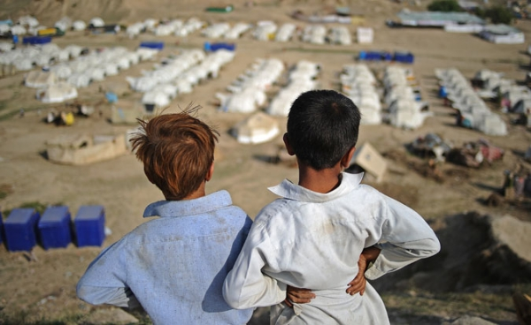 Two boys look out over a large relief camp on September 23, 2010.