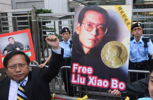 Protesters from Hong Kong's Democratic Party and China Human Rights Lawyers Concern Group demonstrate for the release of jailed Chinese dissident Liu Xiaobao (pictured C) outside the China liaison offices in Hong Kong on October 11, 2010. (Mike Clarke/AFP/Getty Images)