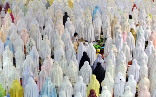Indonesian women pray during the first night of Ramadan in Jakarta on August 10, 2010. The fasting month of Ramadan, which started on August 11, is the ninth month of the Muslim Hijri calendar, during which the faithful abstain from eating, drinking, smoking and having sex during daylight and, in the evening, eat small meals and conduct evening prayers. (Adek Berry/AFP/Getty Images)