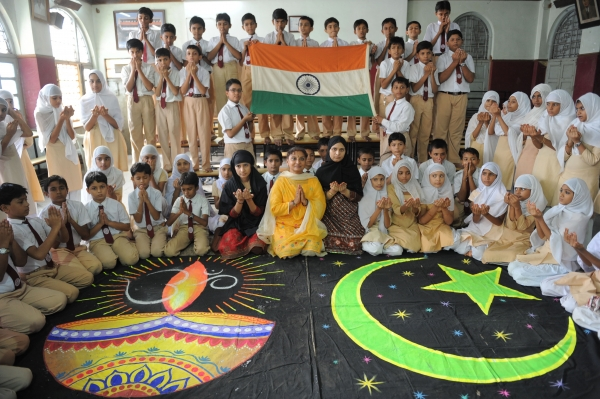 Students and teachers from the Anjuman-E-Islam school pose with Hindu and Islamic religious designs as they pray for a peaceful solution to the Ayodhya Ram Mandir and Babri Masjid issue in Ahmedabad on September 23, 2010. (Sam Panthaky/AFP/Getty Images)