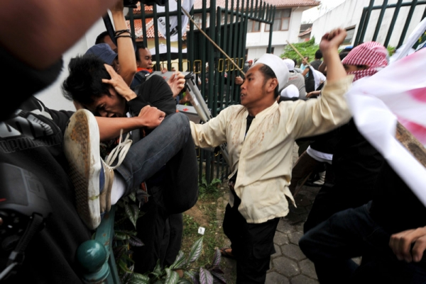 Indonesian Muslim group members clash with supporters of Indonesian rock star Nazril Ariel     outside the court house in West Java on January 31, 2011 after it was announced that he would serve three and a half years in jail over sex tapes. (Bay Ismoyo /AFP/Getty Images)