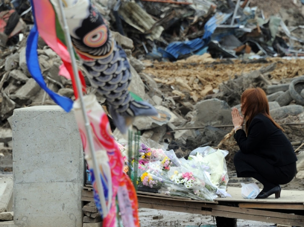 A mother prays for her missing child at the Okawa elementary school in the tsunami-devastated city of Ishinomaki, in Japan's Miyagi prefecture on May 11, 2011. (Toshifumi Kitamura/AFP/Getty Images)