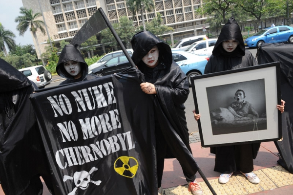 Activists from environmental action group Greenpeace carry portraits of victims from the 1986 Chernobyl nuclear plant disaster during an anti-nuclear protest outside Indonesia's Ministry of Energy and Mineral Resources in Jakarta on April 26, 2010 marking the 24th anniversary of the world's worst nuclear accident in Ukraine and to denounce Indonesia's plans to use nuclear energy. (Romeo Gacad/AFP/Getty Images)