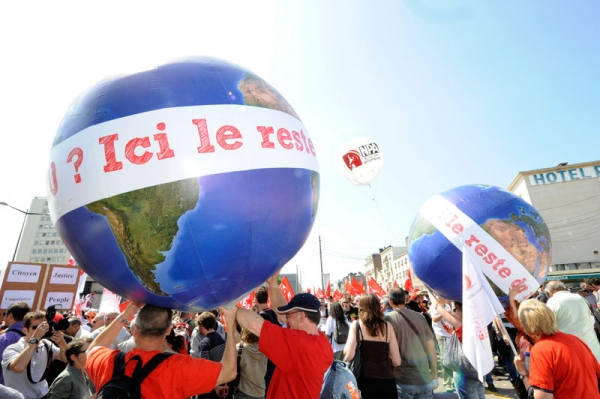 Anti-G8 activists hold globes reading 'Hello G20? This is the rest of the world' as they take part in a demonstration, on May 21, 2011 in Le Havre, northwestern France, to denounce last week's G8 summit in Deauville, France. (Damien Meyer/AFP/Getty Images)