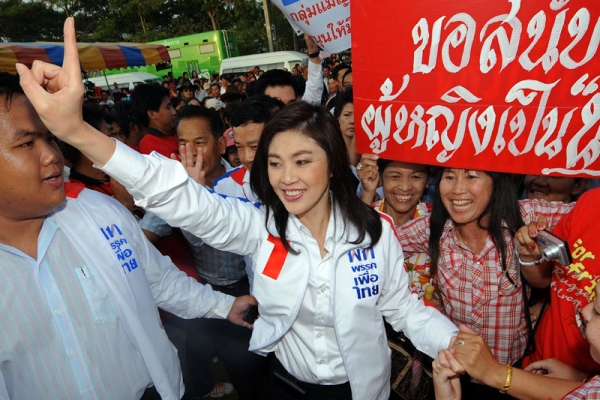 Pheu Thai candidate Yingluck Shinawatra greets supporters in Chiang Rai province on May 22, 2011. Shinawatra and her party went on to win a decisive victory in Thailand's elections on July 3. (Pornchai Kittiwongsakul/AFP/Getty Images)