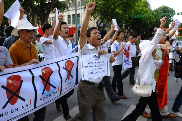 Vietnamese protesters shout anti-China slogans at a rally in central Hanoi on Aug. 14, 2011. About 100 people took to Hanoi's streets to protest against Beijing's territorial ambitions in the South China Sea. (Hoang Dinh Nam/AFP/Getty Images)