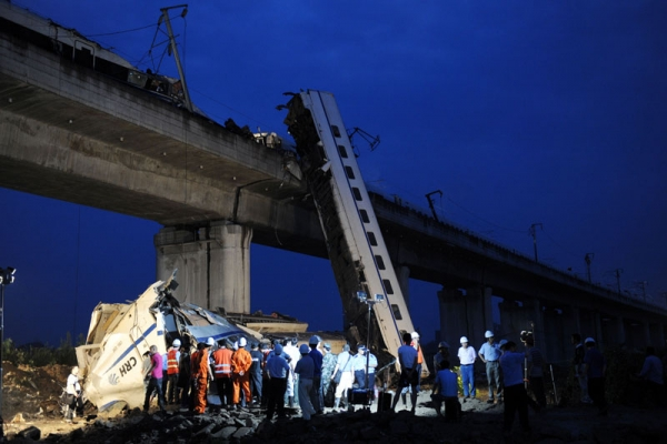 Workers clear wreckage on July 24, 2011 near the city of Wenzhou, in Zhejiang province, after a high-speed train collision a day before. The crash was China's worst rail accident since 2008. (STR/AFP/Getty Images)