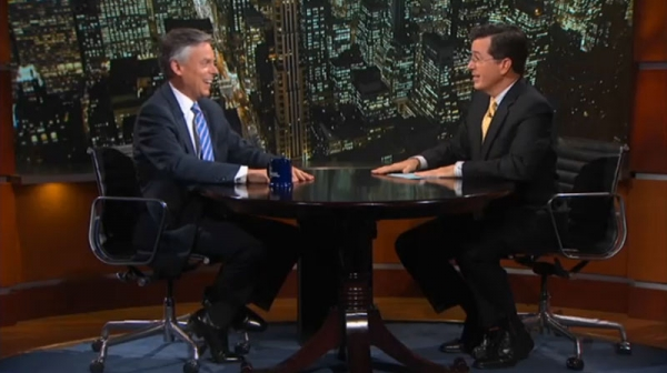 Republican presidential hopeful Jon Huntsman (L) talks to Stephen Colbert on the 'Colbert Report' October 24, 2011.