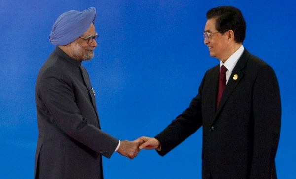 Indian Prime Minister Manmohan Singh (L) shakes hands with Chinese President Hu Jintao (R) during the opening of the BRICS summit meeting in Sanya, Hainan province, on April 14, 2011. (Nelson Ching/AFP/Getty Images)