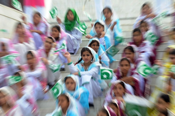 Pakistani students wave national flags at the mausoleum of the founder of Pakistan Muhammad Ali Jinnah in Karachi on August 14, 2011, to mark the 64th Independence Day of Pakistan. (Rizwan Tabassum/AFP/Getty Images)