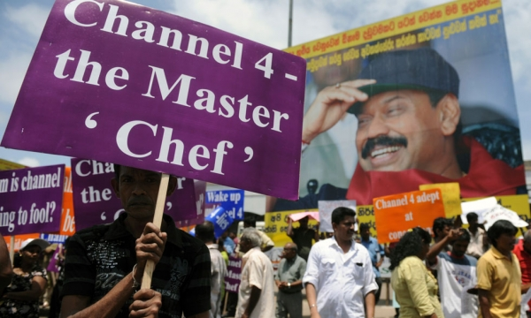 Sri Lankan state workers and ruling party activists protest outside the main railway station in Colombo on August 2, 2011. The protest was aimed to denounce Britain's Channel 4 documentary 'Sri Lanka's Killing Fields'. (Ishara S. Kodikara/AFP/Getty Images)