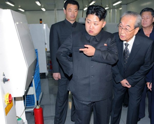"Kim Jong Un (C), dubbed the ""Great Successor"" to Kim Jong Il (not pictured) visits Mokran Video Company in Pyongyang in this undated picture released by the North's official KCNA news agency September 11, 2011."