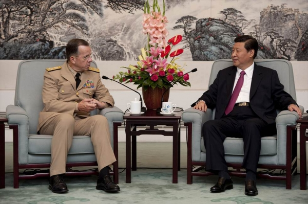 Chinese Vice President Xi Jinping (R), the presumptive heir to current President Hu Jintao, speaks with former Chairman of the Joint Chiefs of Staff Admiral Mike Mullen  in Beijing on July 11, 2011. Xi is just one of several new world leaders who could have a major impact on Asia in 2012 and beyond. Photo by Chad J. McNeeley. (Flickr/Chairman of the Joint Chiefs of Staff)