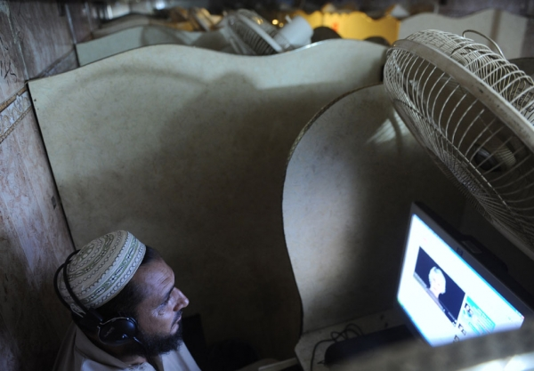 A Pakistani man browses the internet in a net cafe in Karachi on May 31, 2010. (Asif Hassan/AFP/Getty Images)