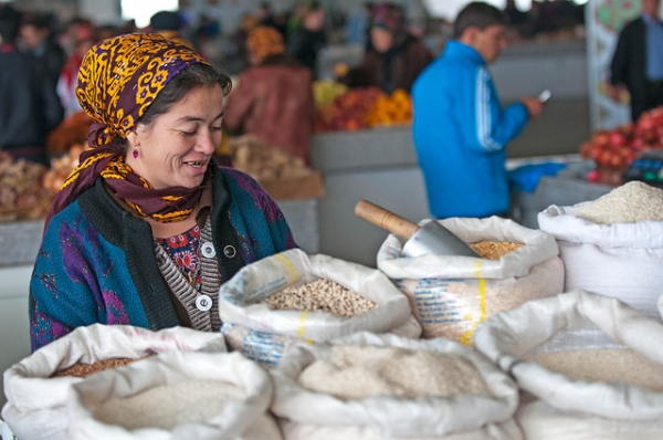 A woman sells grain in a bazaar in Ashkhabad, Turkmenistan on October 30, 2011. (Kerri-Jo/Flickr)