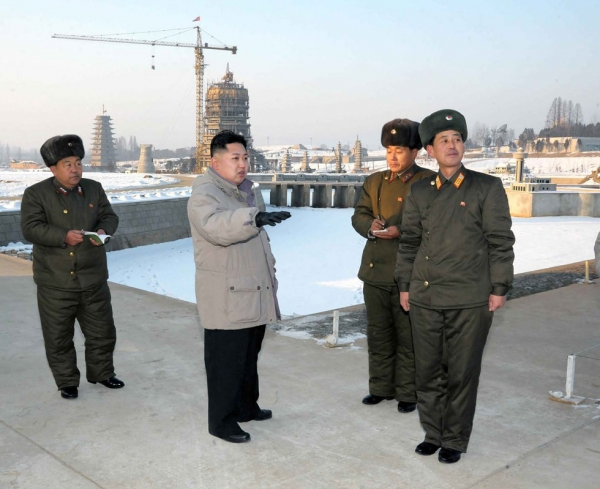 This undated picture, released from North Korea's official Korean Central News Agency on January 12, 2012 shows North Korean leader Kim Jong Un (C) inspecting the planned construction site for the Pyongyang Folk Park, undertaken by Korean People's Army service personnels in Pyongyang. (KNS/KCNA/AFP/Getty Images)