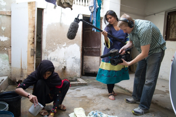 Sharmeen Obaid Chinoy (C) filming 'Saving Face' in the south of Punjab, Pakistan. (Sharmeen Obaid Films)