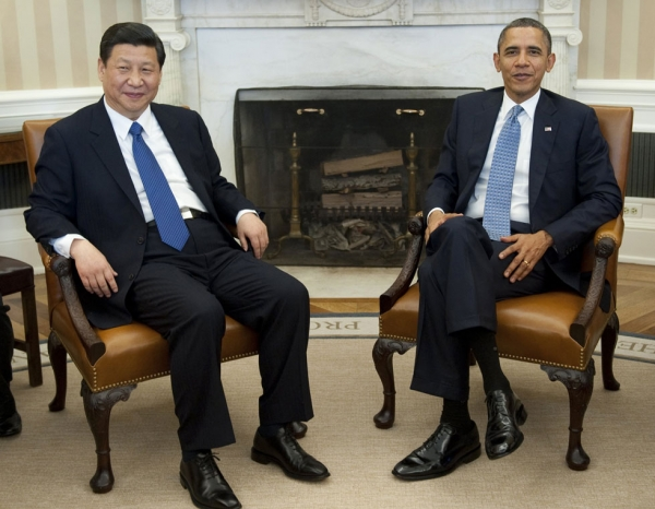 US President Barack Obama and Chinese Vice President Xi Jinping speak during meetings in the Oval Office of the White House in Washington, DC, February 14, 2012. (Saul Loeb/AFP/Getty Images)