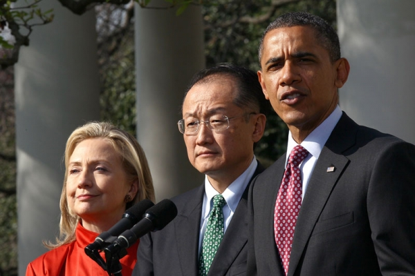 U.S. President Barack Obama (R) announces the nomination of Dartmouth College President Jim Yong Kim (C) for president of the World Bank, as Secretary of State Hillary Clinton (L) looks on, in Washington, DC on March 23, 2012. (Win McNamee/Getty Images)