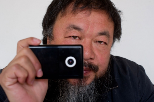 Artist Ai Weiwei holds a webcam that he was reportedly ordered by Chinese police to disconnect, at his home in Beijing on April 5, 2012. (Ed Jones/AFP/Getty Images)
