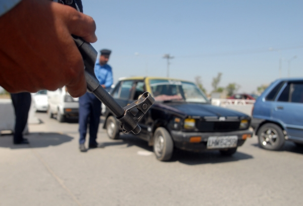 Pakistani policeman stop vehicles at a checkpoint upon their entry into Islamabad on April 30, 2012, ahead of Osama bin-Laden's first death anniversary. (Sajjad Qayyum/AFP/GettyImages)