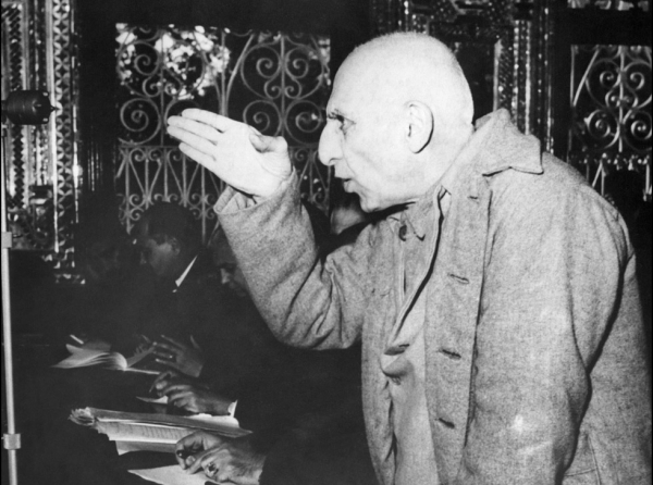 Picture dated 20 November 1953 of Iranian ex-Premier Mohammed Mossadegh using his hand to make a point during one of his frequent interruptions of court proceedings in Tehran's military tribunal, trying him for treason. (STF/AFP/Getty Images)