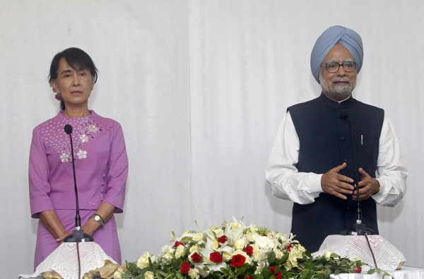 India's Prime Minister Manmohan Singh (R) addresses reporters during a joint press conference following his meeting with Myanmar opposition leader Aung San Suu Kyi at a hotel in Yangon on May 29, 2012. (Soe Zeya Tun/AFP/GettyImages)