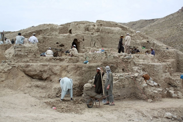 Workers excavate a 2,000-year-old archaeological site discovered in Mes Aynak, Afghanistan in August 2010. (Joanie Meharry)