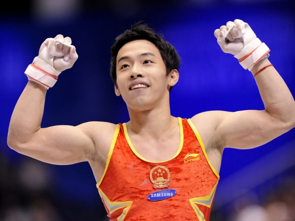 Chinese gymnast Zou Kai, recent victim of a real estate scam, celebrates after a performance at the World Gymnastics Championships in Tokyo on October 16, 2011. (Kazuhiro Nogi/AFP/Getty Images)