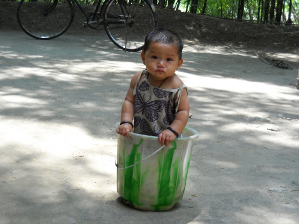 Kid in a bucket: A child in Rowmari, Assam photographed by a relative. (Somaina Basumatary)