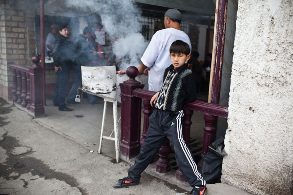 A young Kyrgyz boy hangs out in front of a cafe. (Sue Anne Tay)