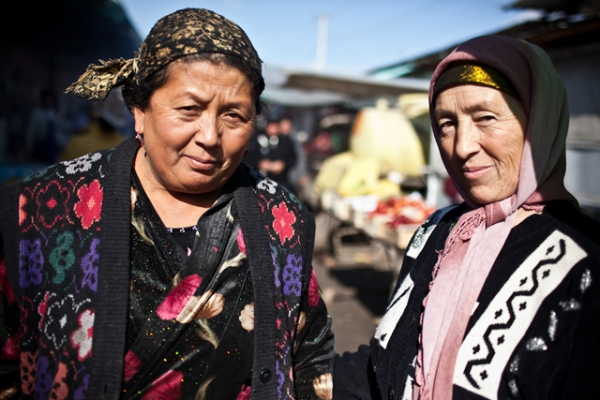 Two Krygyz traders pose for a portrait in Jalalabad Bazaar. (Sue Anne Tay)