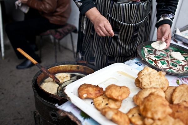 Somsa, a popular Kyrgyz fried snack, sells briskly in the bazaar. (Sue Anne Tay)