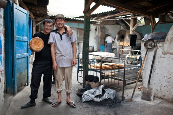 Two brothers in a family operation baking naan, a staple in the Kyrgyz diet. (Sue Anne Tay)