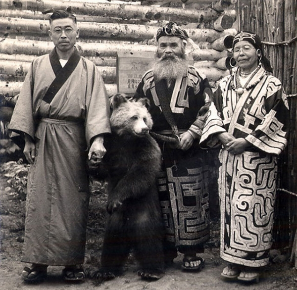 Japanese tourist with two Ainu in Hokkaido, date unknown. (Sgt. Steiner/Flickr)