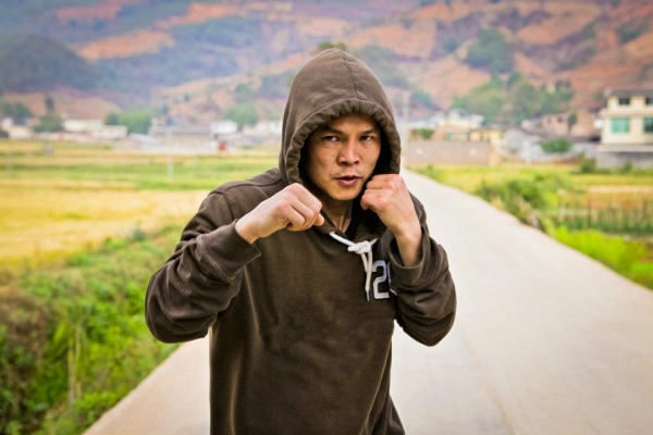 Qi Moxiang, featured in the new documentary China Heavyweight, shadowboxing in rural Sichuan. (EyeSteelFilm)