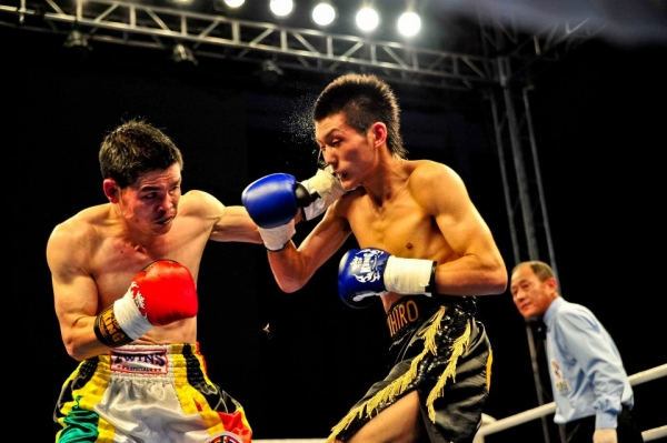 Qi Moxiang (L) vs. Akihiro Matsumoto of Japan (R) at the Vacant WBC Asia Super Bantamweight Championship on June 28, 2011. Their bout is featured in 'China Heavyweight.' (EyeSteelFilm)