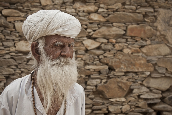 An old man looks suspiciously at the camera in Udaipur, India on February 12, 2012. (Meena Kadri/Flickr)