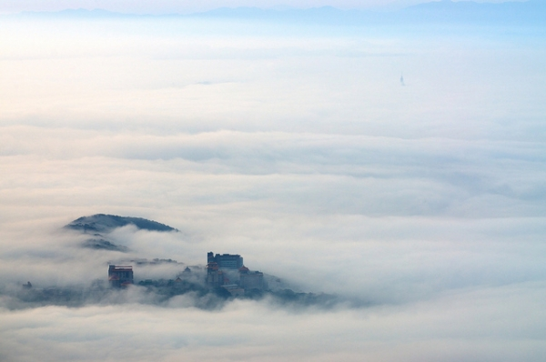 A view of Taipei City from above the clouds on March 1, 2012. (Max Chu/Flickr)