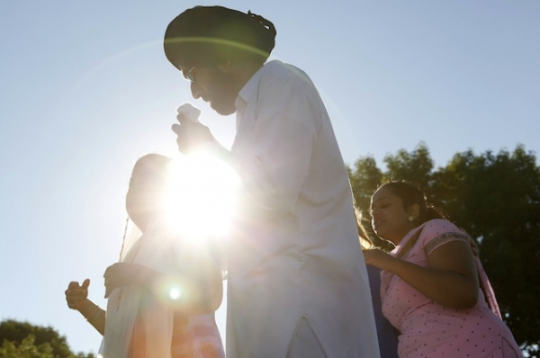 People console each other at the command center near the Sikh Temple of Wisconsin on August 6, 2012. Yesterday a gunman fired upon people at a service in Oak Creek, Wisconsin, killing at least six. (Darren Hauk/Getty Images)