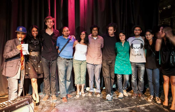 "Participants and performers in the 2012 ""Unification"" event at the Nuyorican Poets Cafe in New York City take a collective bow on August 12, 2012. (Neha Gautam)"