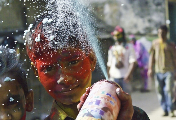 A young boy covered in red powder for Holi, the Festival of Color on March 8, 2012 in Kathmandu, Nepal. (satyamjoshi/Flickr)