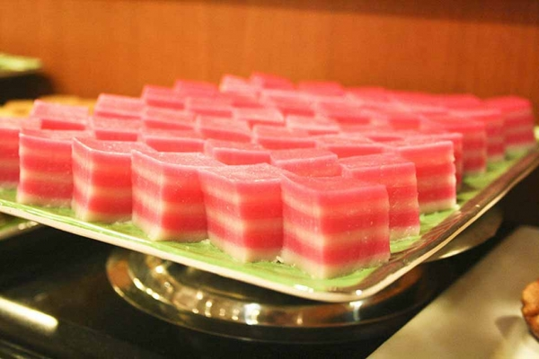Kueh lapis is a layered glutinous steamed cake that is abundant all over Singapore. (multheme/Flickr)