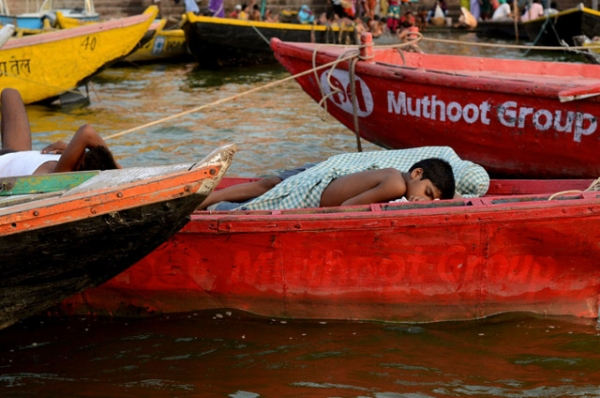 A boy napping in a boat along the banks of Ganges in Varanasi, India on July 2, 2012. (Shivika Sinha)