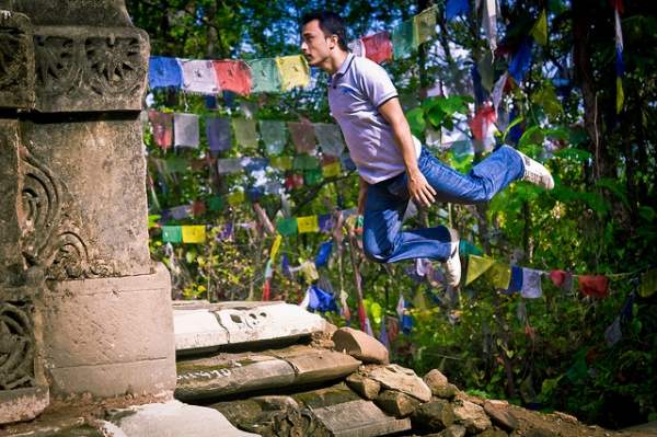 A young man bounces through the ruins in Surkhet, Nepal on July 5, 2012. (satyamjoshi/Flickr)