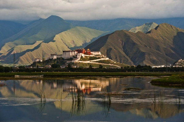 Lhasa's Potala Palace, the monastery that was home to the Dalai Lama, is among the most iconic images of Tibet. The Palace seems to float among the mountains, hovering above the marsh in the foreground. (Michael Yamashita)
