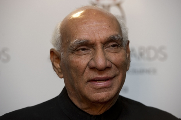 Bollywood filmmaker Yash Chopra poses for the press after winning the Outstanding Achievement in Cinema Award at the Asian Awards at the Grosvenor House Hotel in London on Oct. 26, 2010. (Carl Court/AFP/Getty Images)