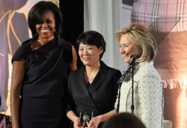 U.S. first lady Michelle Obama (L) and U.S. Secretary of State Hillary Clinton (R) pose with International Women of Courage Award-winner Guo Jianmei, a Chinese lawyer and rights activist, at the Department of State in Washington, DC on March 8, 2011. (Roshan Nebhrajani/Medill DC/Flickr)