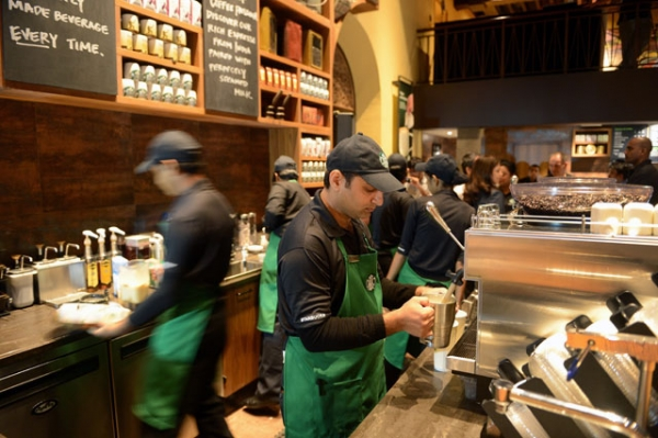 Staff work behind the counter of India's first newly-inaugurated Starbucks outlet in an upscale part of Mumbai on October 19, 2012. (Punit Paranjpe/AFP/Getty Images)