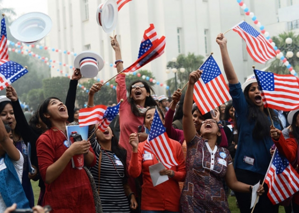 Indian university students celebrate after hearing a prediction that U.S. President Barack Obama was reelected during a U.S. embassy election party at a local hotel in Delhi on November 7, 2012. (Roberto Schmidt/AFP/Getty Images)